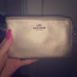 Coach gold wristlet with tags. Real.